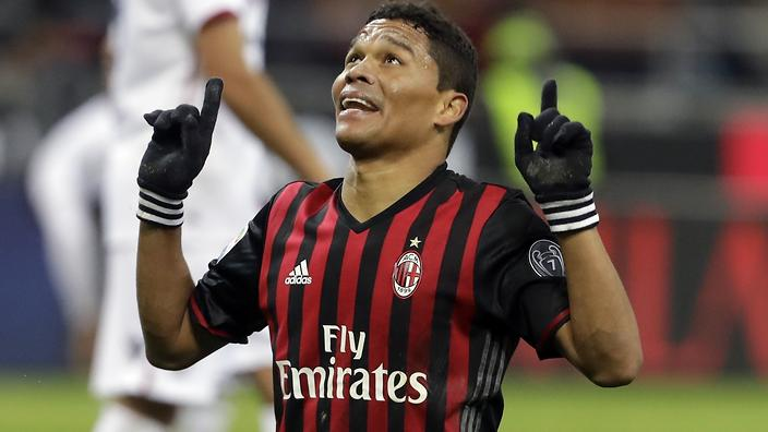 AC Milan's Carlos Bacca celebrates after scoring the winning goal during a Serie A soccer match between AC...<br />